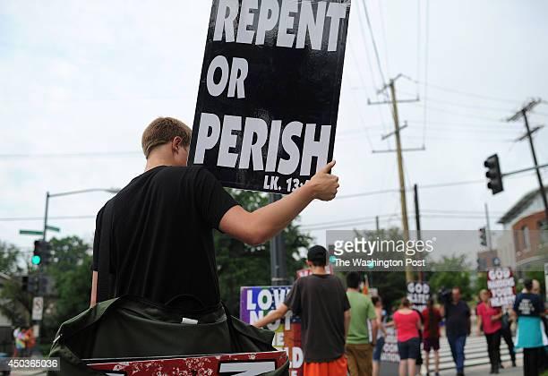 Members of Westboro Baptist Church protest near Woodrow Wilson High School on Monday June 09 2014 in Washington DC The high school's principal Pete...