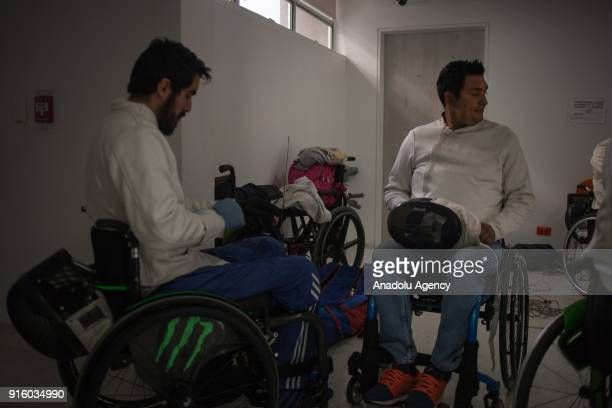 Members of wheelchair fencing team of Archangeles are seen during a training at the Police Center in Bogota Colombia on February 8 2018 One of the...