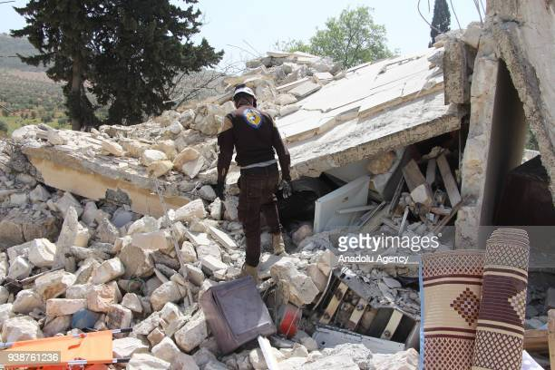 Members of White Helmet inspect the wreckage of a collapsed house after booby traps set by YPG/PKK exploded in Shamanli village of Sheran district...