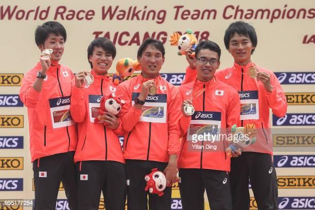 Members of winner team Japan Daisuke Matsunaga Koki Ikeda Isamu Fujisawa Toshikazu Yamanishi and Eiki Takahashi pose for photo during medal ceremony...
