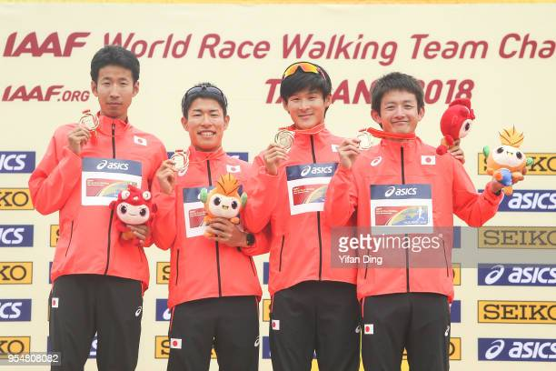 Members of winning team Japan Hirooki Arai Kai Kobayashi Satoshi Maruo and Hayato Katsuki take a group shot during the team medal ceremony of Men's...