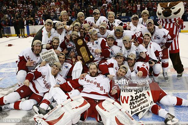 Members of Wisconsin celebrate after defeating Boston College 2-1 in the NCAA Mens Hockey National Championship at the Bradley Center in Milwaukee,...