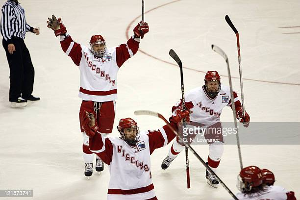 Members of Wisconsin celebrate after taking the lead during 3rd-period action against Boston College in the NCAA Mens Hockey National Championship at...