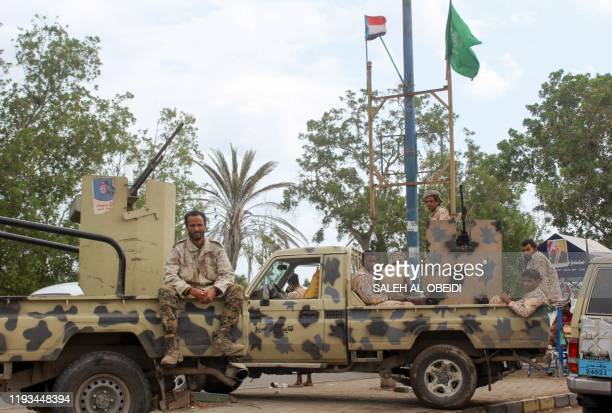 Members of Yemen's southern separatist-dominated Security Belt Forces stand guard during a meeting of the Southern Transitional Council in the...