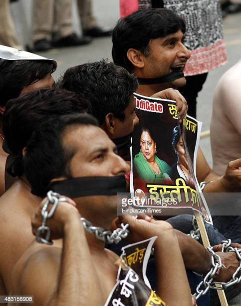Members of Youth Congress protest shirtless against the BJP government demanding the resignation of Madhya Pradesh Chief Minister Shivraj Singh...