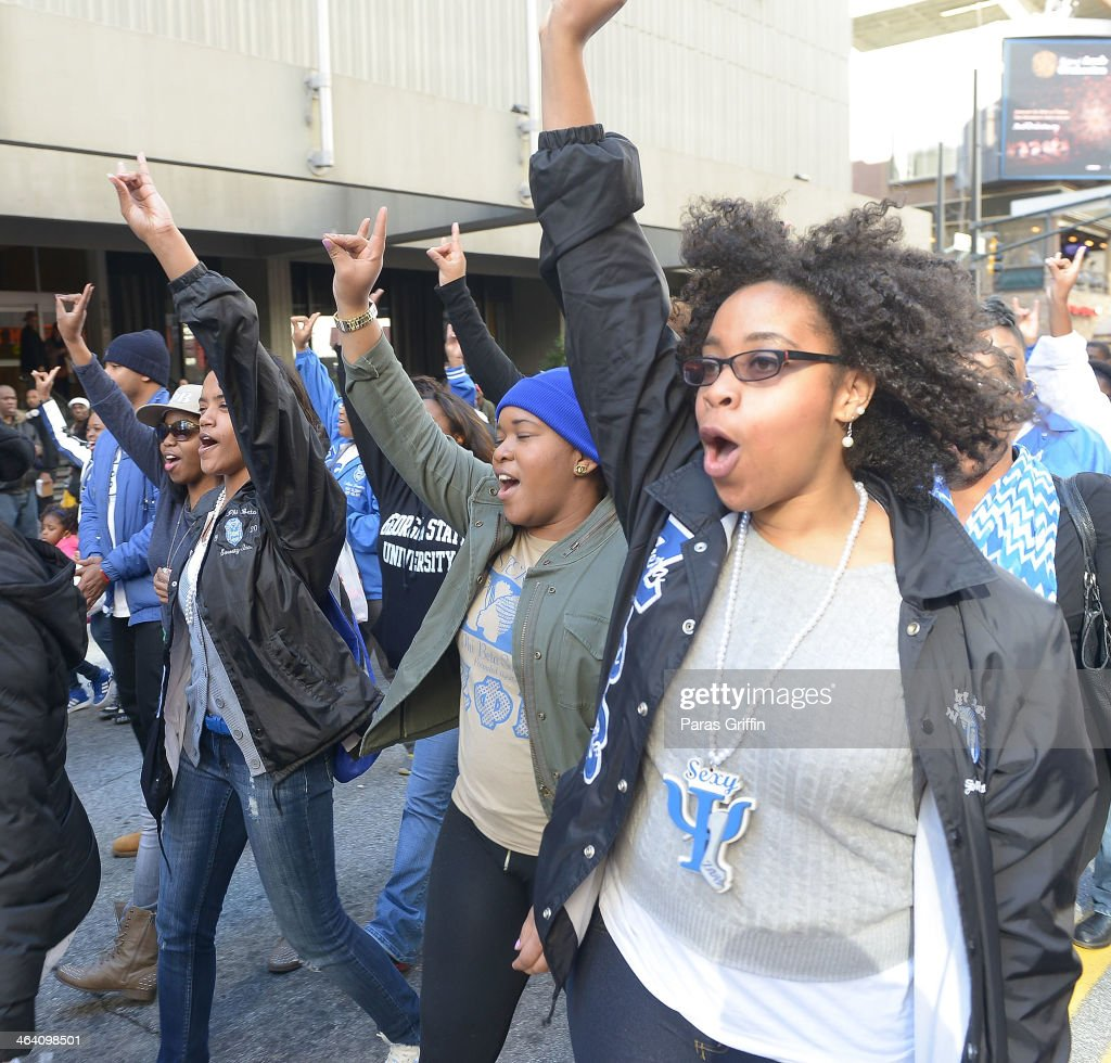 Members of Zeta Phi Beta Sorority, Inc. participates in the 2014 Martin Luther King, Jr. March & Rally at Peachtree Street on January 20, 2014 in Atlanta, Georgia.