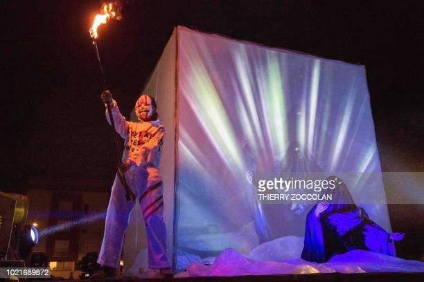 Members ot the Insectotropics theatre company perform the show the Legend of Burning Man on August 22 2018 in Aurillac on the first day of the...
