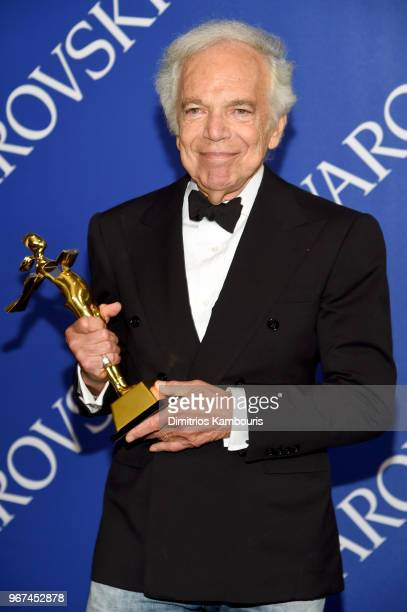 Members Saulte award winner Ralph Lauren poses with award at the 2018 CFDA Fashion Awards Winners Walk at Brooklyn Museum on June 4 2018 in New York...