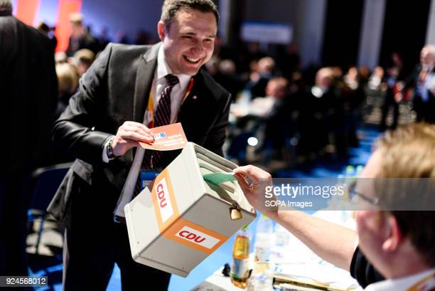 Members seen casting their ballots for the election of CDU General Secretary in the ballot box during the 30th congress of the CDU. The CDU votes...