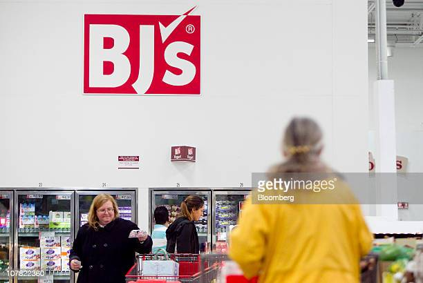 Members shop inside a BJ's Wholesale Club store in Falls Church Virginia US on Thursday Dec 30 2010 BJ's Wholesale Club Inc rose 71 percent in New...
