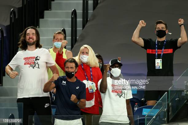 Members sitting in the box of Serena Williams of the US, including her husband Alexis Ohanian and coach Patrick Mouratoglou , cheer her on against...