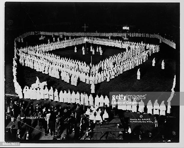 KKK members stand in a square formation at a rally in West Virginia 1924