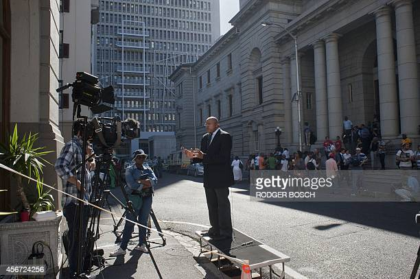 Members the media congregate outside in the Cape Town High Court for the start of the trial of British murder accused Shrien Dewani on October 06 in...
