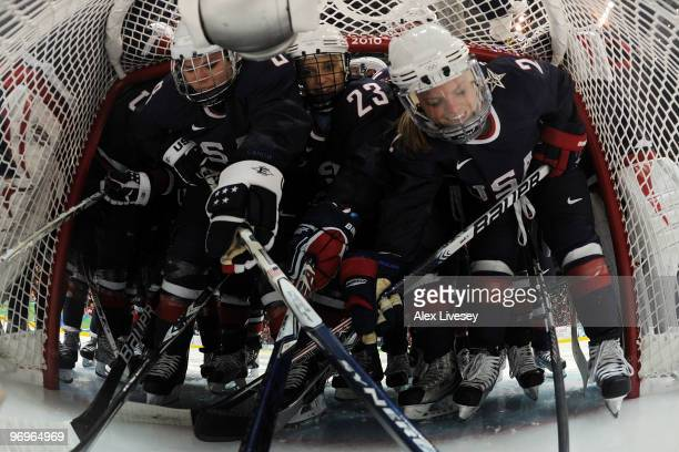 Members the United States gather in the net before the game against Sweden during the ice hockey women's semifinal game game between on day 11 of the...