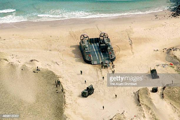 Members unload vehicles from a hovercraft that landed on Ukujima island during a joint training exercise on April 14, 2015 in Sasebo, Nagasaki,...