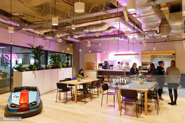 Members use a break-out area in the WeWork Cos. Co-working space at the One Poultry building in the City of London, U.K., on Wednesday, Oct. 3, 2018....