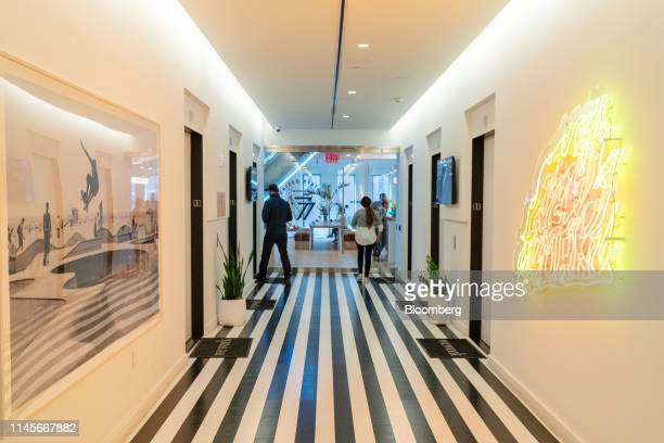 Members walk through the lobby of the WeWork Cos Inc. 85 Broad Street offices in the Manhattan borough of New York, U.S., on Wednesday, May 22, 2019....