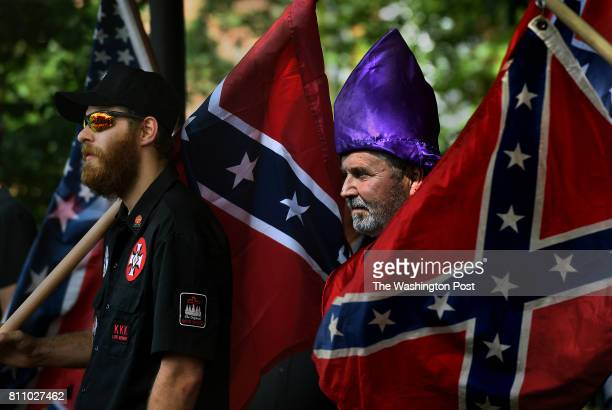 KKK members watch as antiKKK groups chanted against them A KKK group from North Carolina called the Loyal White Knights protested in Justice Park...