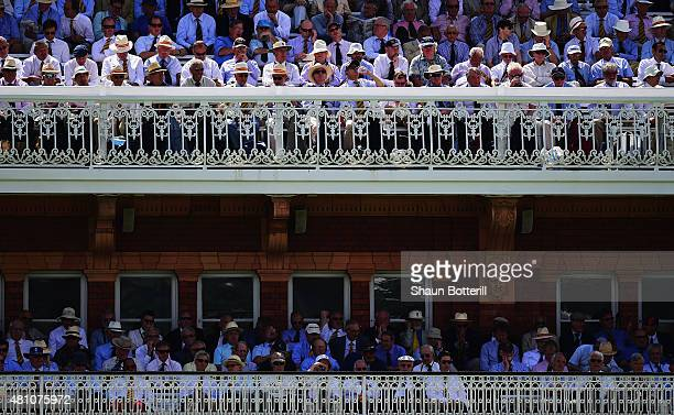 Members watch from the pavillion during day two of the 2nd Investec Ashes Test match between England and Australia at Lord's Cricket Ground on July...
