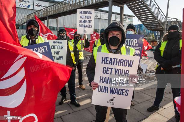 Members working in the engineering department hold a picket line at Hatton Cross as they go on strike against wage cuts at Heathrow Airport on...