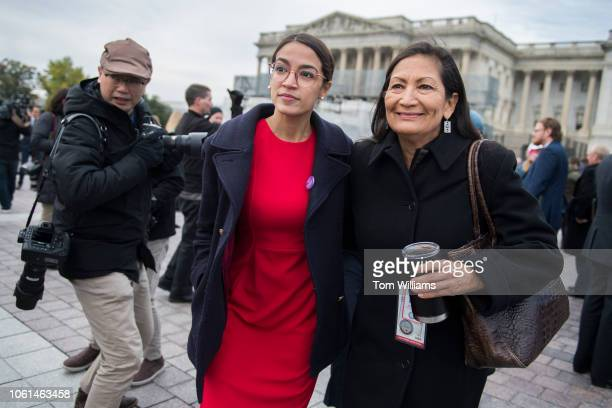 Memberselect Alexandria OcasioCortez DNY left and Deb Haaland DNM are seen after the freshman class photo on the East Front of the Capitol on...