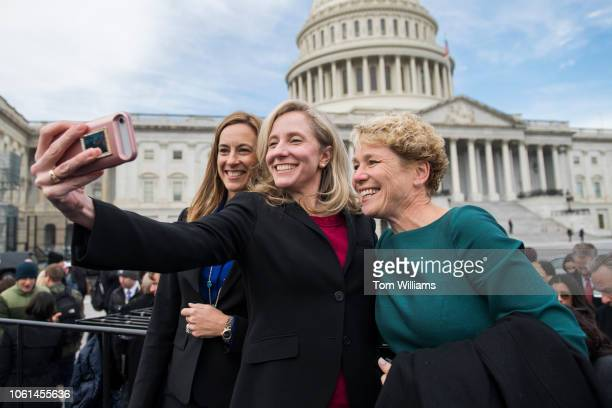 Memberselect from left Mikie Sherrill DNJ Abigail Spanberger DVa and Chrissy Houlahan DPa take a selfie after the freshman class photo on the East...