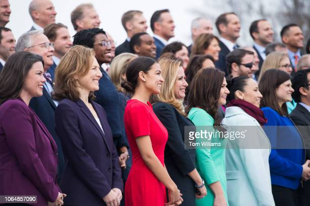Memberselect including Alexandria OcasioCortez DNY in red pose for the freshman class photo on the East Front of the Capitol on November 14 2018