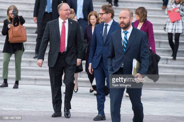 Members-elect Jim Hagedorn, R-Minn., left, and Dean Phillips, D-Minn., make their way to the freshman class photo on the East Front of the Capitol on...