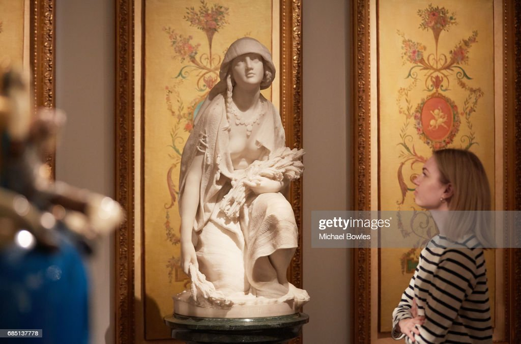 A memeber of Sotheby's observes Professore Rossi's white marble sculpture 'Ruth' (est. £30,000-50,000), at Sotheby's on May 19, 2017 in London, England.