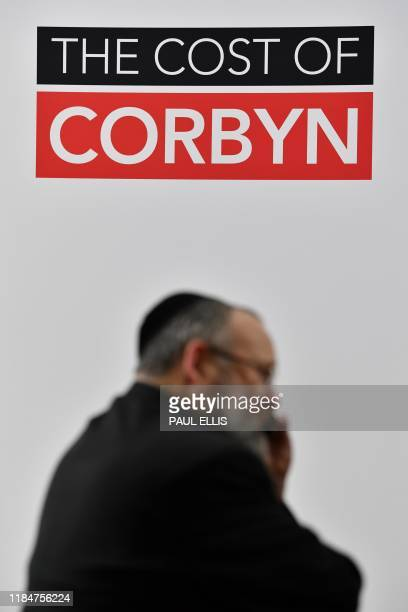 A memeber of the Jewish community looks on prior to Britain's Chancellor of the Exchequer Sajid Javid's speech at a general election campaign event...