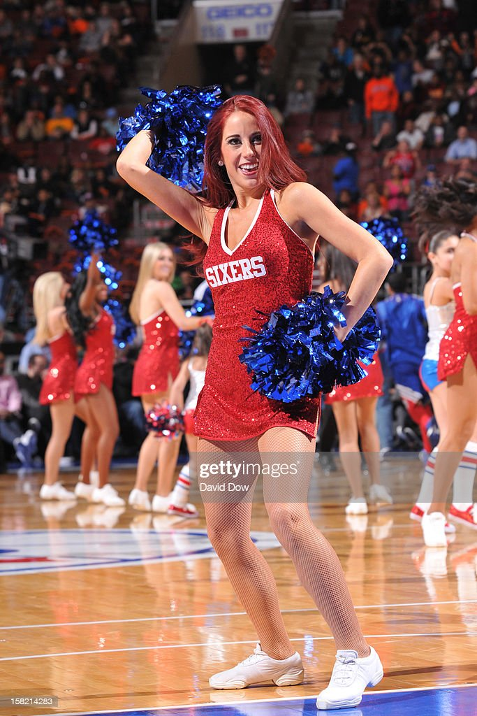A memeber of the Philadelphia 76ers dance team performs during halftime against the Detroit Pistons during the game at the Wells Fargo Center on December 10, 2012 in Philadelphia, Pennsylvania.