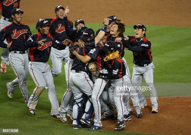 Memebers of team Japan celebrate on the mound after defeating Korea during the finals of the 2009 World Baseball Classic on March 23, 2009 at Dodger...