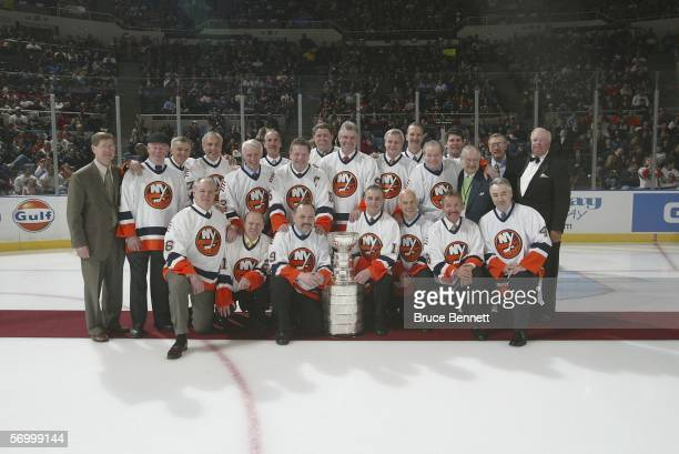 Memebers of the 1980 New York Islanders pose for a team photo during a ceremony honoring the 25th anniversary of the Islanders first Stanley Cup...