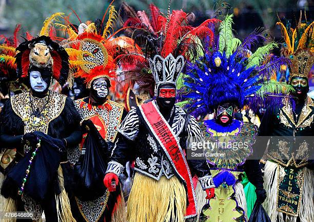 Memebers of the Krewe of Zulu parde dispite ther rain Mardi Gras day on March 4 2014 in New Orleans Louisiana Fat Tuesday the traditional celebration...