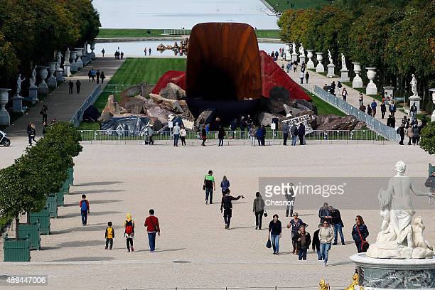 Memebers of the public view 'Dirty Corner' by BritishIndian sculptor Anish Kapoor which is partially covered to hide antisemetic vandalism in the...