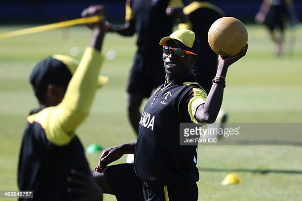 Memebers of the Uganda cricket team warmup prior to an ICC World Cup qualifying match against Uganda on January 19 2014 in Mount Maunganui New Zealand