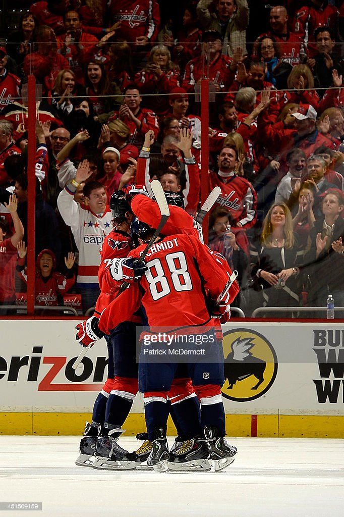 Memebers of the washington Capitals celebrate with Alex Ovechkin #8 after his 3rd period goal during an NHL game against the Montreal Canadiens at Verizon Center on November 22, 2013 in Washington, DC.