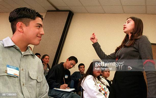MEMechaesteem2KH2/27/96Ben Guerrero a sophomore from Anaheim High School listens with interest to Natalie Mendoza a senior at Cal State Fullerton...