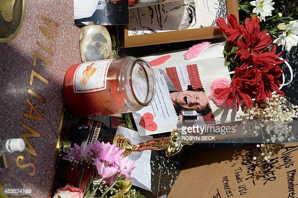 Mementos left at a makeshift memorial to actor/comedian Robin Williams at his star on the Hollywood Walk of Fame August 12 in Hollywood California...