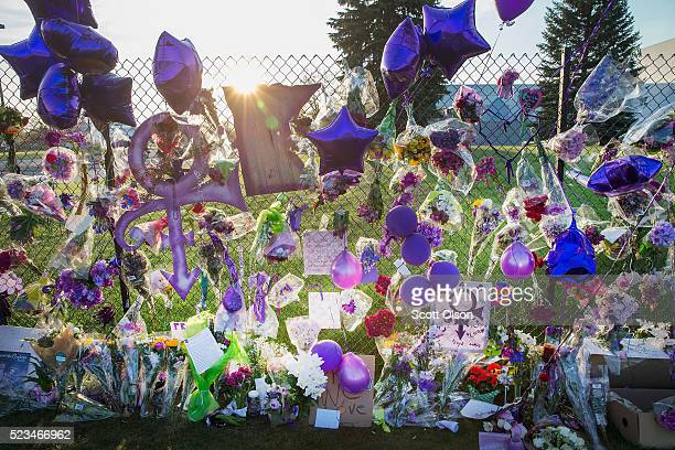 Mementos left by fans are attached to the fence which surrounds Paisley Park the home and studio of Prince on April 23 2016 in Chanhassen Minnesota...