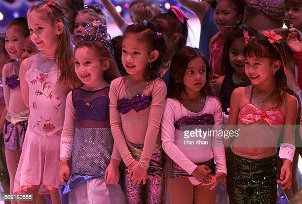 MEMermaid31229DIK Anaheim December 29Little girls dressed in Little Mermaid costume wait for the results of 'Ariel Sing Skate' competition they took...