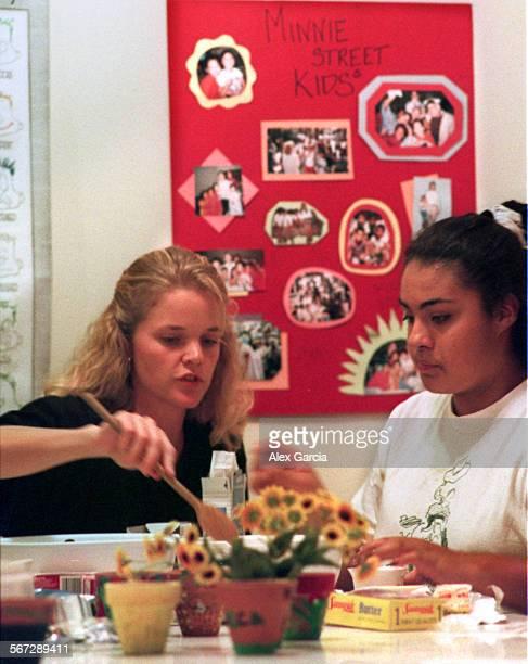 MEmissionellen#41122AAG––kodak[g]––Missionary Ellen Peirson shows Cristina Machado how to mix baking ingredients to create a dessert during a girls...