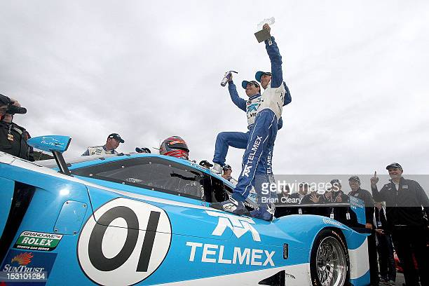 Memo Rojas and Scott Pruett celebrate after winning the 2012 GrandAm Rolex Series Championship at Lime Rock Park on September 29 2012 in Lakeville...