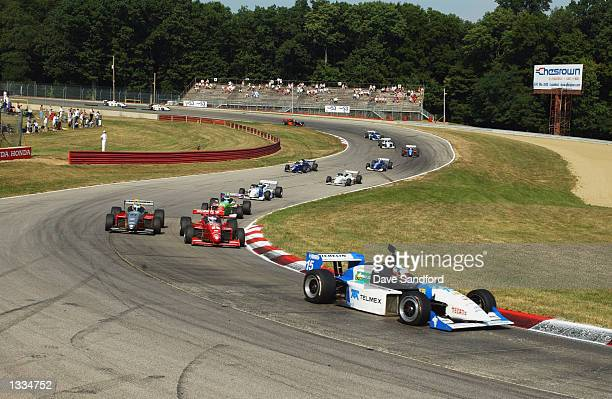 Memo Rojas with camera mounting leads a pack through the esses during the Barber Dodge Pro Series race at the CART Grand Prix of MidOhio round 11 of...