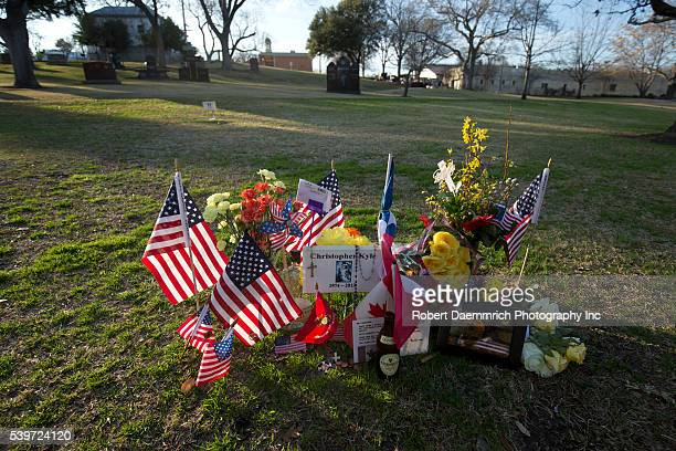 Memorabilia adorns the Texas State Cemetery grave of US Navy Seal sniper Chris Kyle near the Texas State Capitol Kyle the most prolific sniper in US...
