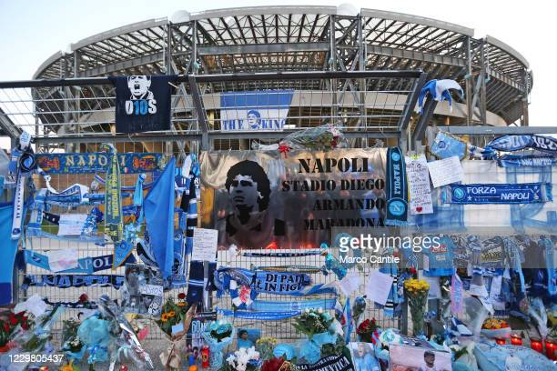 Memorabilia and tealights of Diego Armando Maradona, with a giant plaque that names the stadium to the champion, in front of the San Paolo stadium in...