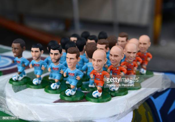 Memorabilia are displayed for sale at a stall outside the stadium before the UEFA Champions League group F match between SSC Napoli and Manchester...