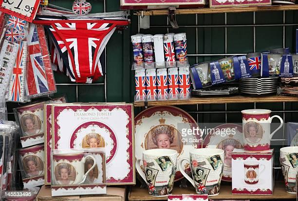 Memorabilia celebrating the Diamond Jubilee of Her Majesty Queen Elizabeth II on sale in Trafalgar Square on June 1 2012 in London England With two...