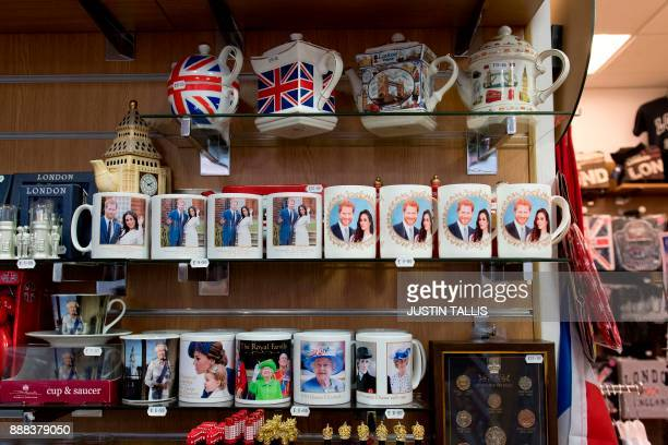 Memorabilia celebrating the engagement of Britain's Prince Harry to fiancée US actress Meghan Markle are pictured for sale with other royal souvenirs...