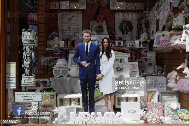 Memorabilia for the Royal Wedding of Britain's Prince Harry and Meghan Markle is displayed in a shop in Windsor on May 18 on the eve of the wedding....